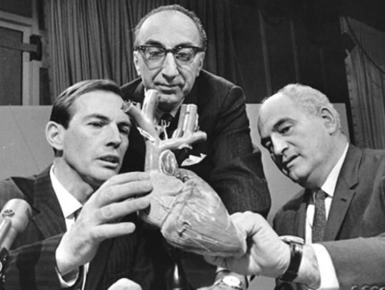 Three titans of heart surgery (from left), Christiaan Barnard of South Africa, Michael DeBakey of Houston, and Adrian Kantrowitz, conferred on the set of the CBS program ''Face the Nation.'' First <3 transplant