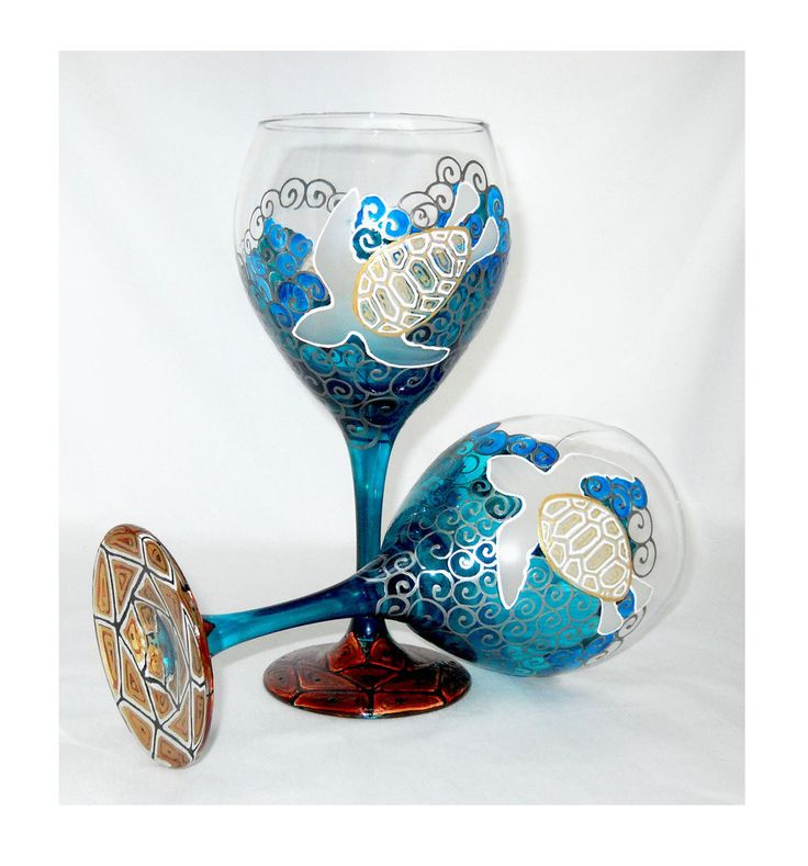 Sea turtle wine glasses hand painted blue waters with silver scrolling motion in…