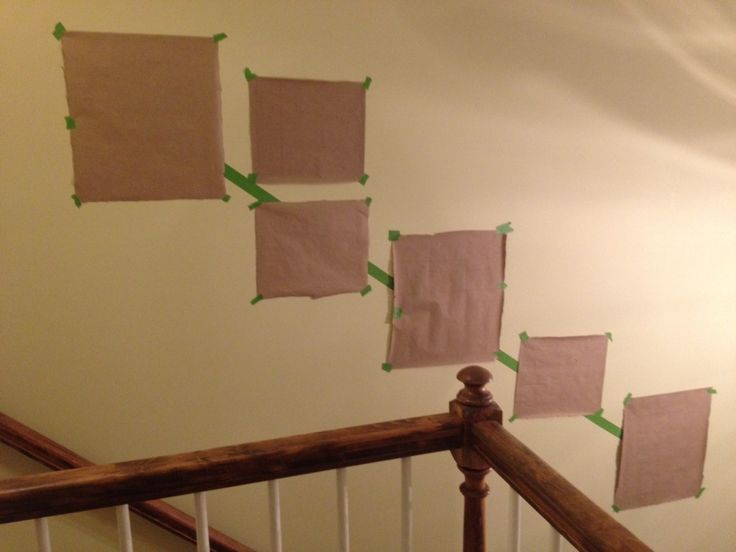 How to hang a photo gallery along a staircase - something to remember if I ever get around to hanging pictures on the staircase wall...