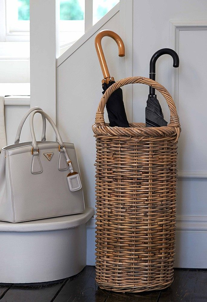 This rattan basket has a large curved handle over the top – a really nice detail – and a practical removable internal metal drip tray.