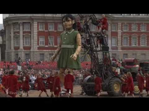 Uploaded on May 19, 2006  On Sunday 7th May the Little Girl Giant woke up at Horseguards Parade in London, took a shower from the time-traveling elephant and wandered off to play in the park... (The music is 'Decollage', by Les Balayeurs du Désert) - HD version also available here on my channel -