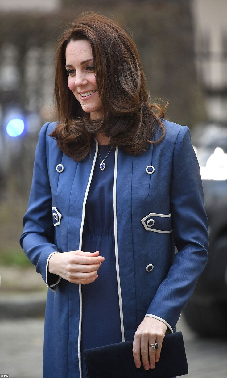 Head to toe blue: The Duchess paired her vibrant coat with a pair of blue suede pumps, a sapphire pendant and matching earrings as she touched down in Marylebone on Tuesday morning