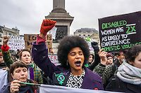 London,England,UK: 20th Nov 2016: Sister Uncut assembly in Trafalgar Square against domestic  violence services cut. March and blockade of Waterloo bridge mostly venerable group are Black and Minority Ethnic women 4 in 5 who approach refuges are turned away and lighting flare as they march in London,UK. Photo by See Li