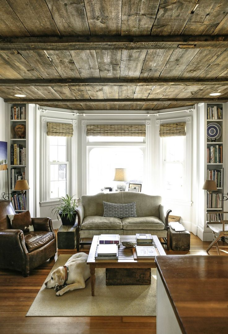 Miles & Antena's Laid Back Coastal Home. The living room with that rustic wood ceiling is gorgeous. And the comfortable mix of furniture and leather goods. And that dog!