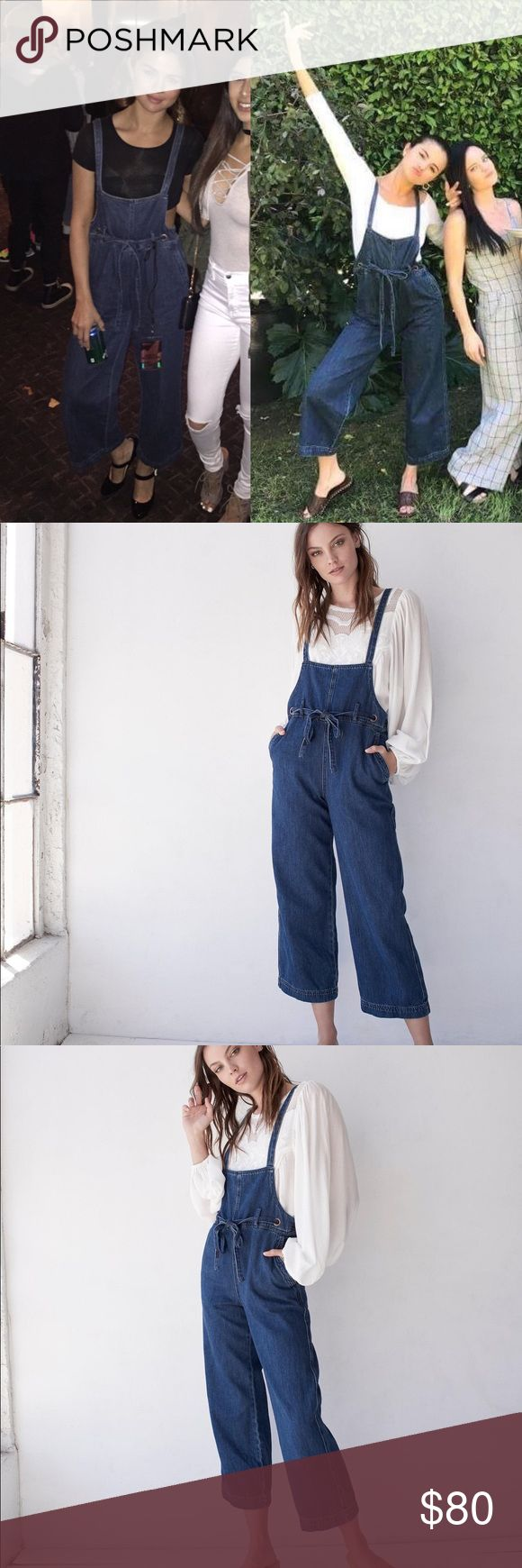Free People Strappy Denim Overalls Selena Gomez SOLD OUT for ages now. As seen on Selena Gomez, exact match. Brand new with tags, never worn. Comes from smoke-free, pet-free home.  Cropped denim one piece featuring an adjustable drawstring waistband.  Lightweight rigid denim Crisscross strappy adjustable back Wide legs Low bib front detail Free People Jeans Overalls