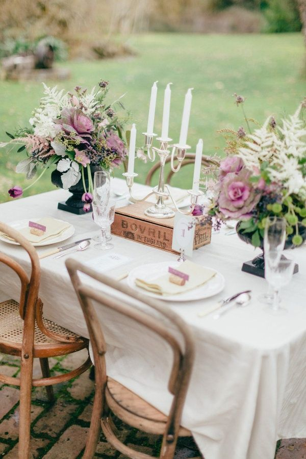 Love the cabbage flowers and the simple wood chair. Rustic outdoor wedding table chic | http://www.fabmood.com/tablescapes/t51/