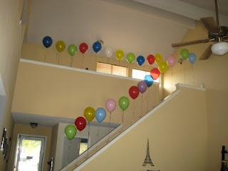 Happy birthday hubby: 26th birthday balloons tied to the staircase. Attached to