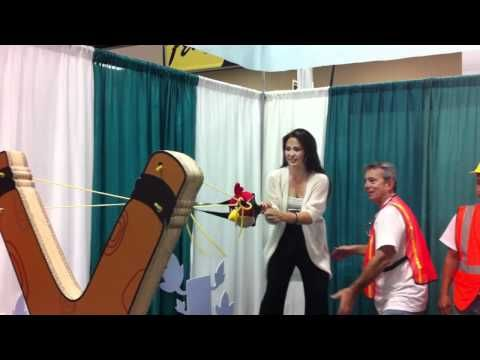 Taking her best shot from the giant Angry Birds sling shot at the 2011 PBTE