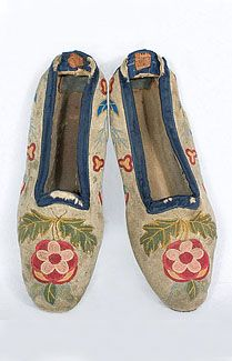 Native American deerskin slippers, c.1820s. Most early Colonial shoe styles were hand produced and worn until they died; very few examples survive. The deerskin slippers are hand embroidered with a chain stitch pattern of abstract florals. The upper edge is bound with navy silk ribbon. The inside is lined with ivory cotton, and the sole is lined with linen. The soles are leather.1820S Embroidered, Native Americans, American Indian, Woman Shoes, Deerskin Slippers, American Deerskin, 1840 American, 1820 1840, Stitch Patterns
