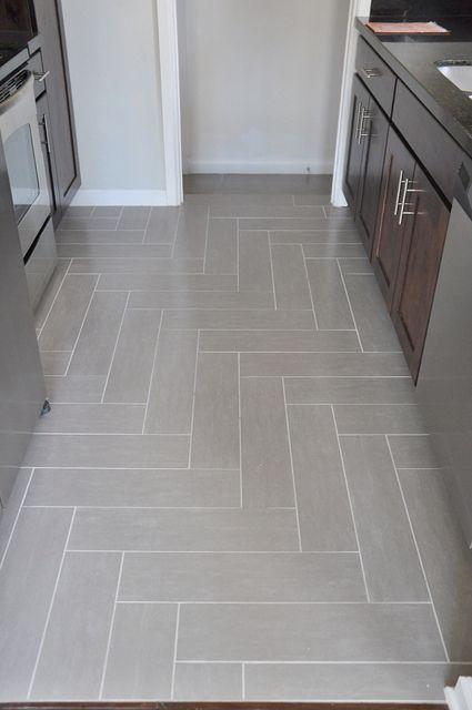 Righy angle herringbone tile floor by Lindsay Redd Design