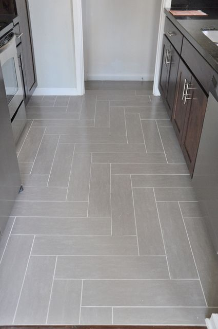 Righy angle herringbone tile floor by Lindsay Redd Design