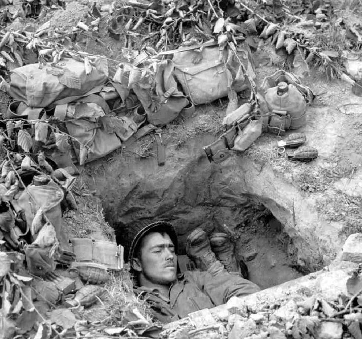 American GIs resting in (deep) foxhole, Europe, 1944. Soldiers, history, photograph, photo b/w.