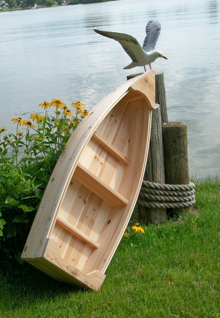 Nautical wooden outdoor landscape all cedar boat garden box planter lawn or yard ornament decoration. $109.00, via Etsy.