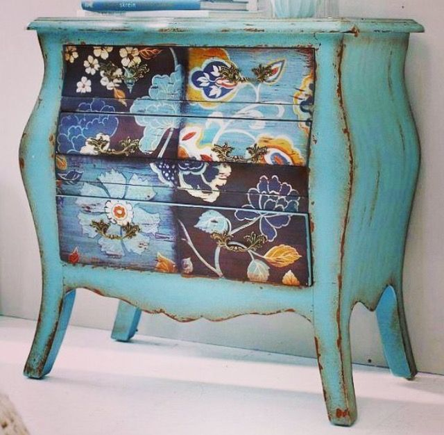 Turquoise painted whimsical bombay chest.