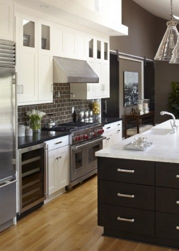 Dark subway tile with white grout. Hate trying to keep grout clean near the stove, but the rest of the backsplash...Back Splashes, Kitchens Design, Contemporary Kitchens, Colors, Kitchens Ideas, Urrutia Design, Subway Tiles, White Cabinets, White Kitchens