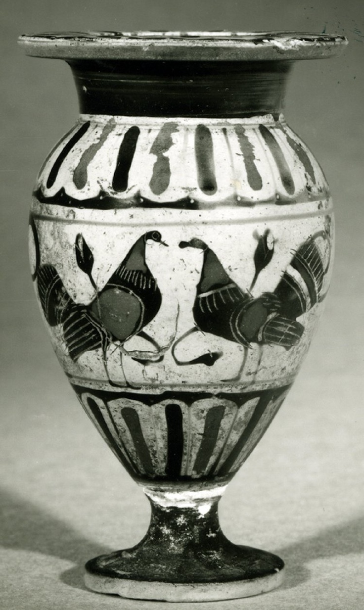 Pottery: black-figured lydion: confronted lions and cocks.