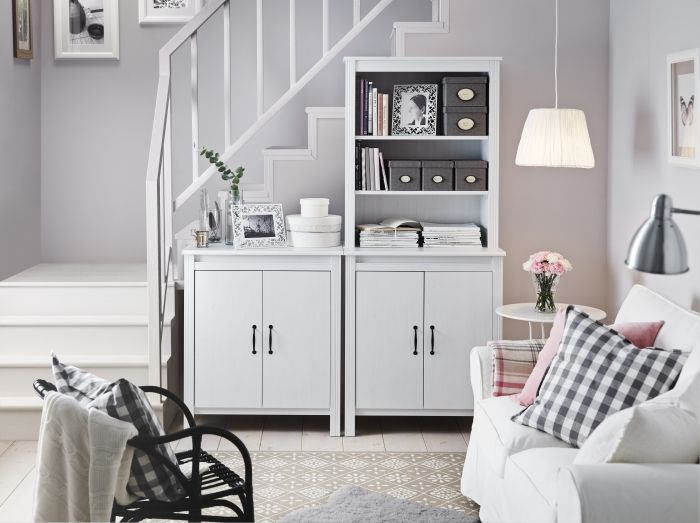 A Bright Living Room With White Cabinets One Low Doors And High Open Storage At The Top Shown Together Two Seat Sofa