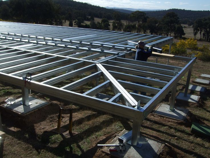 Installing the wrap around deck / verandah section of the steel frame kit.