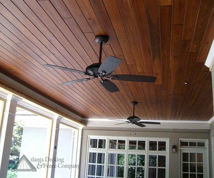 Perfect stain color for porch ceiling Love the fan too. Ask about brown or black trim for can lights.