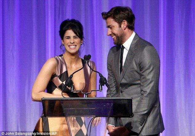 Hilarity: Sarah and John Krasinski shared a laugh on stage at the podium...