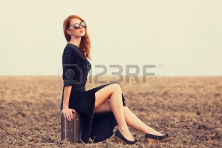 Fashion redhead women with suitcase at autumn field Stock Photo - 21279528