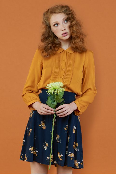 Mustard and navy pair perfectly. Try pairing a mustard blouse with a navy skirt for work or an everyday fall look!