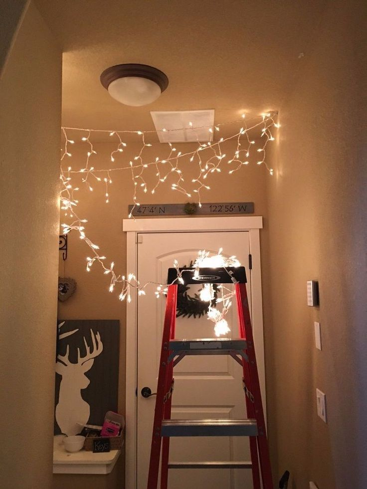 Mom sticks command strips on her hallway ceiling for a genius trick