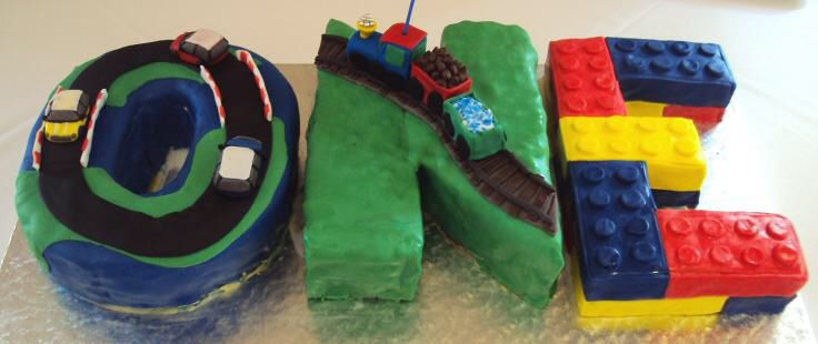 """First birthday cake for my son . The theme was """"My favourite toys"""""""