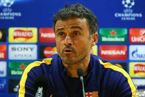 Barca coach Luis Enrique had to be restrained by 3 people as he tried to remonstrate with a Spanish television journalist after his side's 4-0 humiliation by PSG in the Champions League .