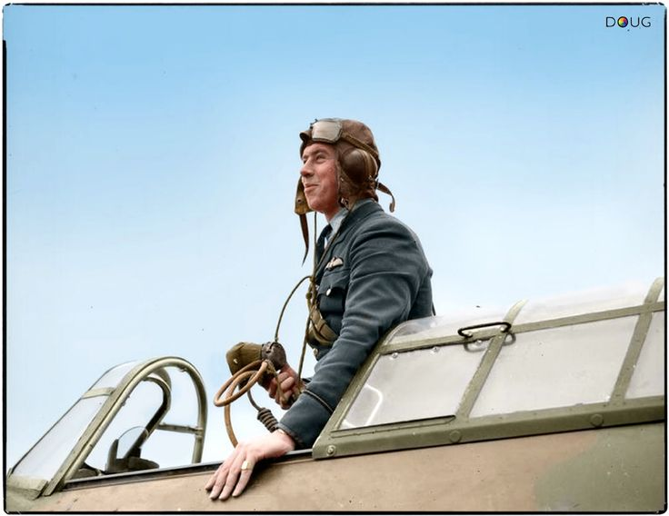 """New Zealand, Flying Officer E J Kain of No. 73 Squadron, standing in the cockpit of his Hawker Hurricane Mark I """"Paddy III"""" at Rouvres, in the Île-de-France Region in north-central France."""