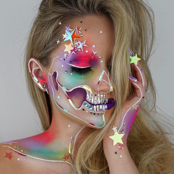 Makeup artist and wig maker, Vanessa Davis, posts amazing skeleton cosmetic creations to her Instagram account and uses glitter, sequins, and even Swarovski