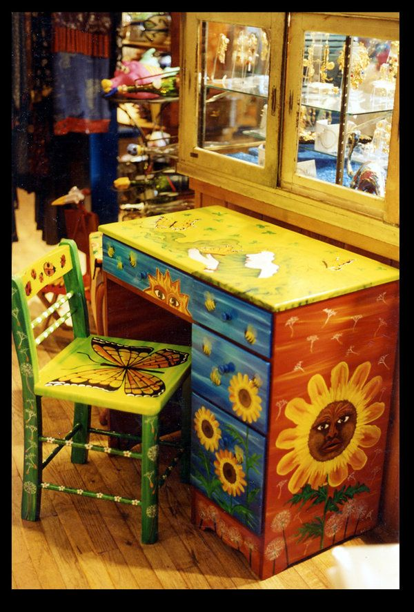 Vintage desk painted with springtime colors, bright flowers, and butterflies. This design is copyrighted by Reincarnations Painted Furniture. All Rights Reserved. (may be used by clubs/features on DA)
