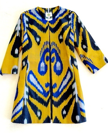 """A CJ Laing signature piece - Incredible graphic impact - one of a kind, imported hand-loomed silk/cotton ikat meticulously tailored in our New York workroom. Jewel neck, 3/4 length sleeves, on-seam pockets, fully lined. Light as air, our coats grace the wardrobes of many women on the """"Best Dressed List"""". They are worn over our cigarette pants at cocktail parties in Palm Beach, and in Aspen over jeans and cowboy boots. These coats go way beyond fashion ~ they are timeless, wearable art. dry…"""