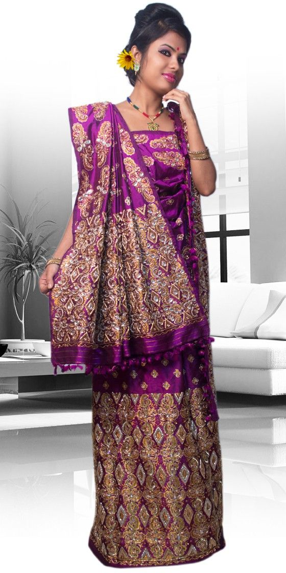 Beautiful Purple colour Assam Silk Pat Mekhla Chadar. This is a traditional bridal collection with artistic chumki work.The set is outlined with Naksi Stone thread.This is a three piece set i.e.Chaddar, Mekhala and Blouse Piece. The Mekhla Chadar comes with matching blouse piece, the blouse shown in the image is just for display purpose.Slight colour variation may be there in display & acutal.