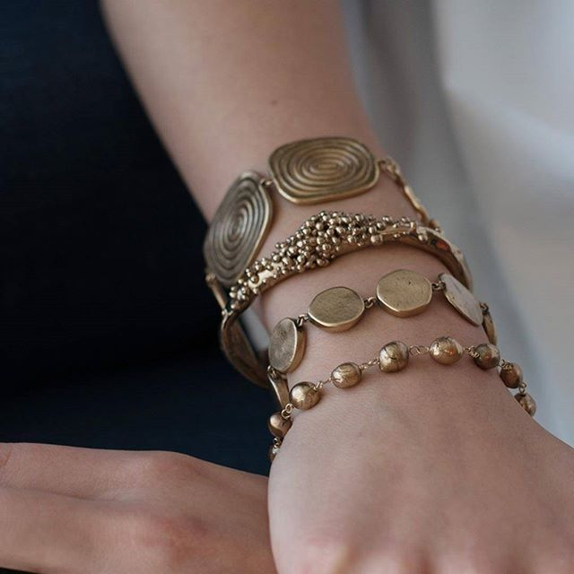 Stacking bracelets From top to bottom: Vortex, Caviar, Abacus, and Helena bracelets in Bronze.