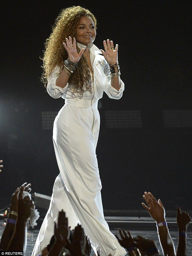 White hot: The 49-year-old legend graced the stage donning a billowy white jumpsuit...