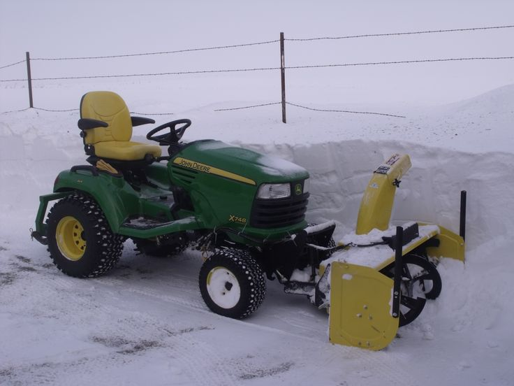 "John Deere X748 with front mounted snow thrower.  I've always heard the ""JD 318's were the best garden tractor ever built"". Anyone that says that never used an X748!"