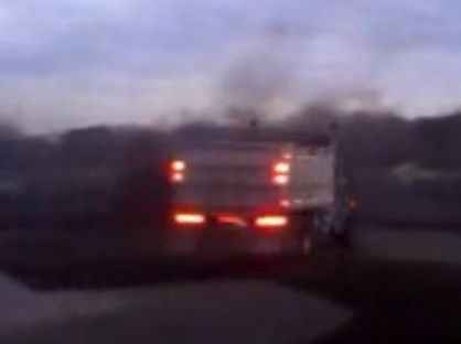Click to see a Peterbilt Dump Truck doing Donuts! Ya think this guy still has a job after the Boss saw this?