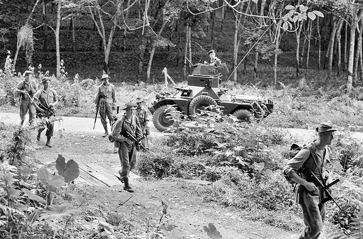 Ferret scout car of 1st King's Dragoon Guards supporting anti-terrorist operations during the Malayan emergency, 1957.