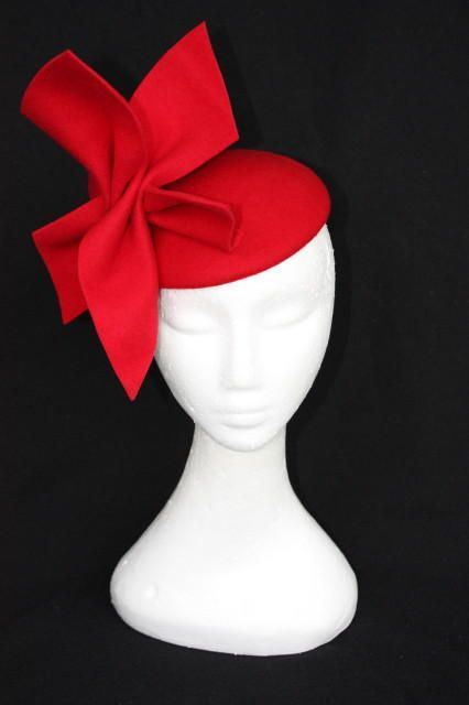 red felt cocktail hat. I want to go somewhere that I could wear this
