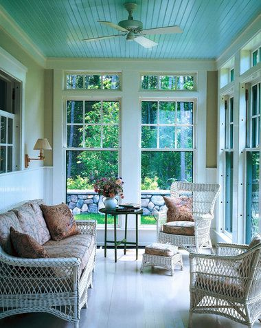 Blue porch ceiling - a Southern tradition to prevent bees/wasps from making nests in the ceiling corners. I just love them anyway. This looks like a 3-season room.