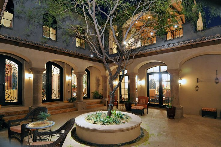Spanish Style Homes with Courtyards | Spanish Colonial Estate - Luxury Calvis Wyant Homes.