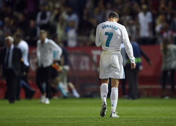 Real Madrid's Portuguese forward Cristiano Ronaldo walks on the field after a goal by Girona during the Spanish league football match Girona FC vs Real Madrid CF at the Montilivi stadium in Girona on October 29, 2017. / AFP PHOTO / Josep LAGO