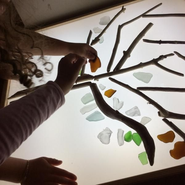 Tree with beach glass on light table-From Twitter-A Recipe For Wonder ‏@wonderstaples