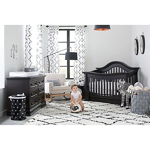 Babies are drawn to graphic prints and high-contrast colors. For a balance, pair black-and-white textiles and toys with solid furnishings. Both classic and stylish, this simple color combo ties a room together and has the look and feel of high-end design.