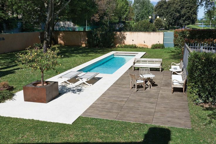 Beautiful poolside featured with ceramic oak wood tiles for outside