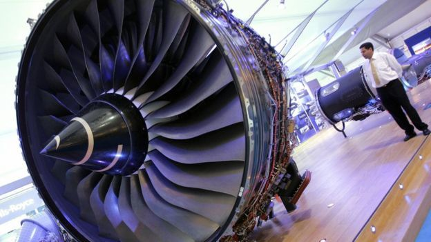 A visitor looking at a Rolls Royce Trent 900 jet engine, used on the Airbus A380-800 and A380F at the Farnborough air show
