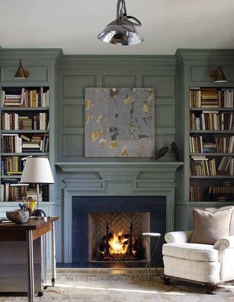 deep grey-blue, built-in bookcases with jointed sconces above, herringbone detail in fireplace