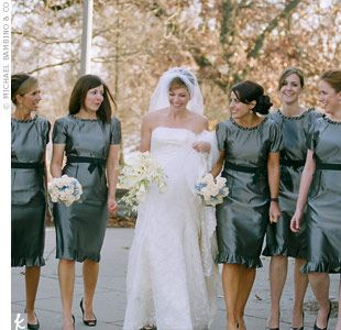 """Lara describes her bridesmaid looks as, """"very Audrey Hepburn."""" The knee-length pewter dresses by Vera Wang had elegant extras like ruffled hems and ribbons at the waist."""