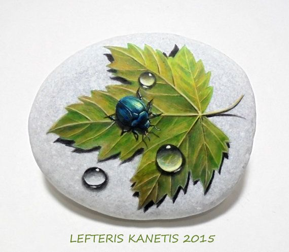 Painted Rock with Beetle, Dew Drops And Autumn Leaf!Is Painted with high quality Acrylic Paints and finished with Glossy varnish protection.